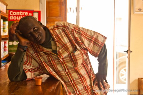 Patient getting his daily dose of medicine in a Saint-Louis pharmacy, Senegal. Photo by Marko Preslenkov.