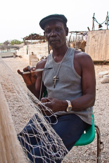 A man working on brand new fishnet in Fadiout, Senegal. Photo by Marko Preslenkov.