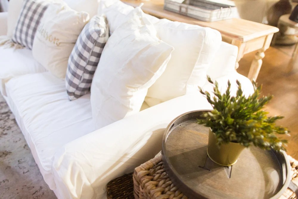 white slipcovered sofa living room window treatments ideas for truth about with kids and pets so in this post i m going to address why bought a how keep my clean the is holding up since