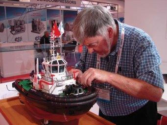 Close-up of Ron B. fixing tug model in Hamburg, Germany