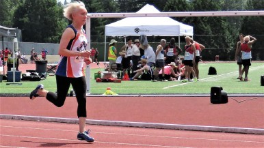 Avril Douglas, fleet as a feather, down the backstretch of a 400-meter dash