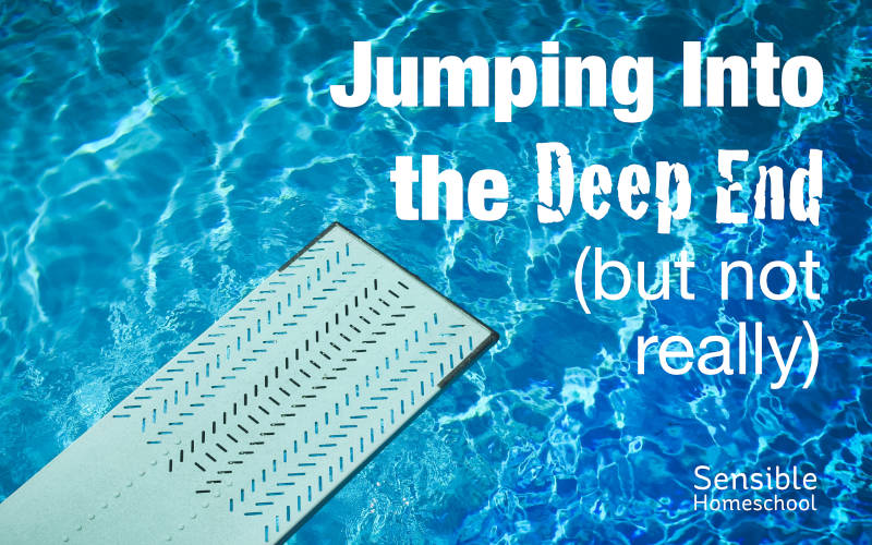 Jumping into the deep end diving board over blue pool