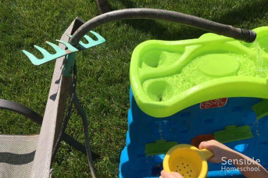 resourceful homeschooler outdoor hose rake water contraption