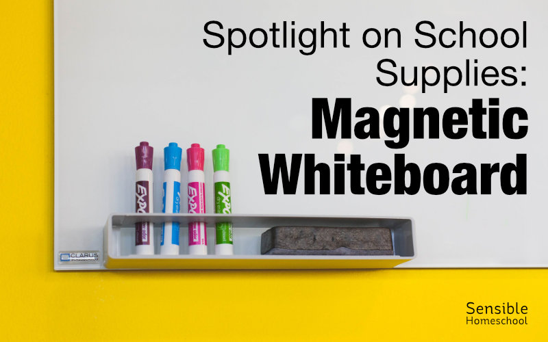spotlight on school supplies magnetic whiteboard background with markers and eraser