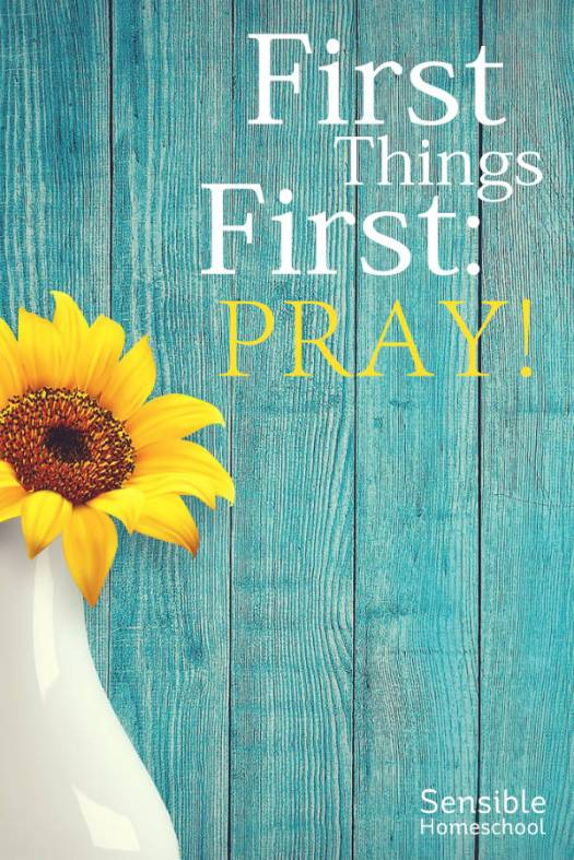 First things First: Pray! on aqua fence background with yellow flowers in vase