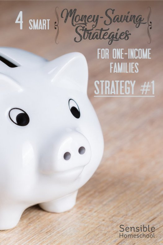 4 Smart Money-Saving Strategies for One-Income Families title on wood background with piggy bank