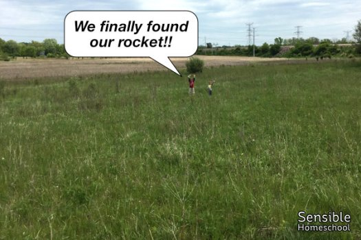 "boys far away in field with text ""We finally found our rocket!!"""