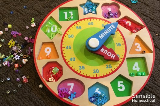 Toy clock shape puzzle with beads sorted by color