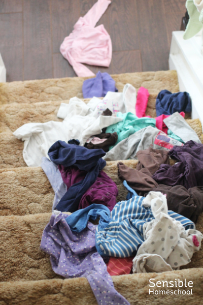 Toddler clothes strewn all over stairs