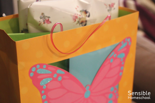 Butterfly gift bag with presents inside.