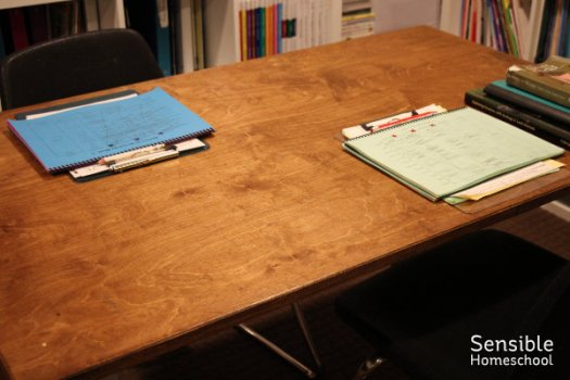 Clean homeschooling table with checklists