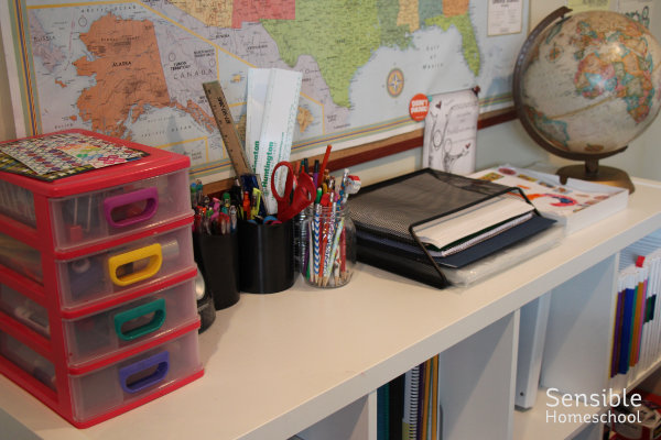 homeschool shelf with supplies and globe