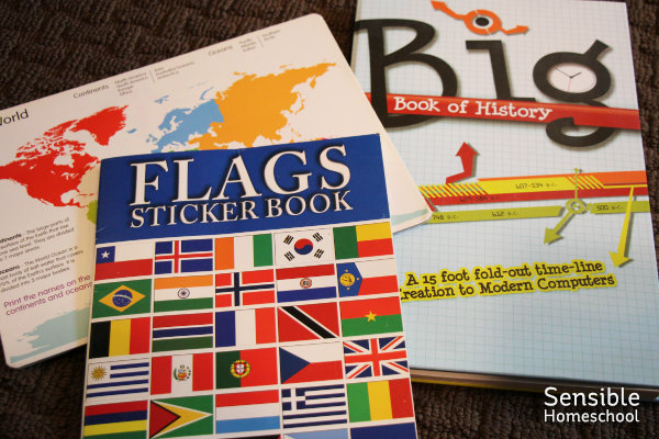 Homeschool history resources including Flags Sticker book, AIG Big Book of History and a whiteboard map