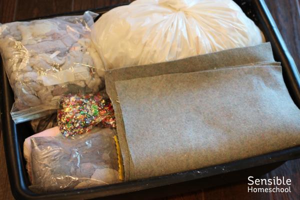 Paper making craft supplies stored in wash tub bin
