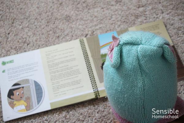 Preschooler reading her AWANA Cubbies book