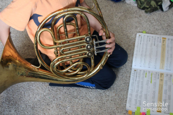 3rd grade homeschooler practicing French horn for band