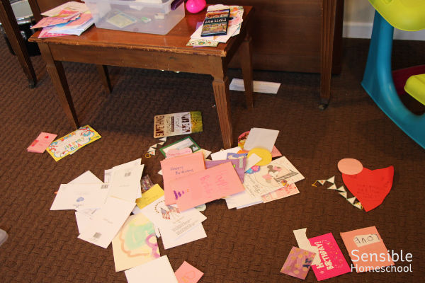 cards and papers scattered on the floor