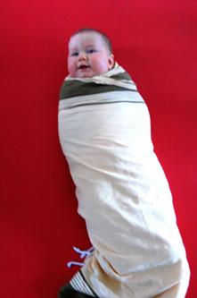 Stevig inbakeren of rollen in een deken Adviezen voor ouders