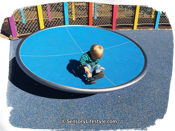Magical Bridge Playground  - Josh enjoying spinning time