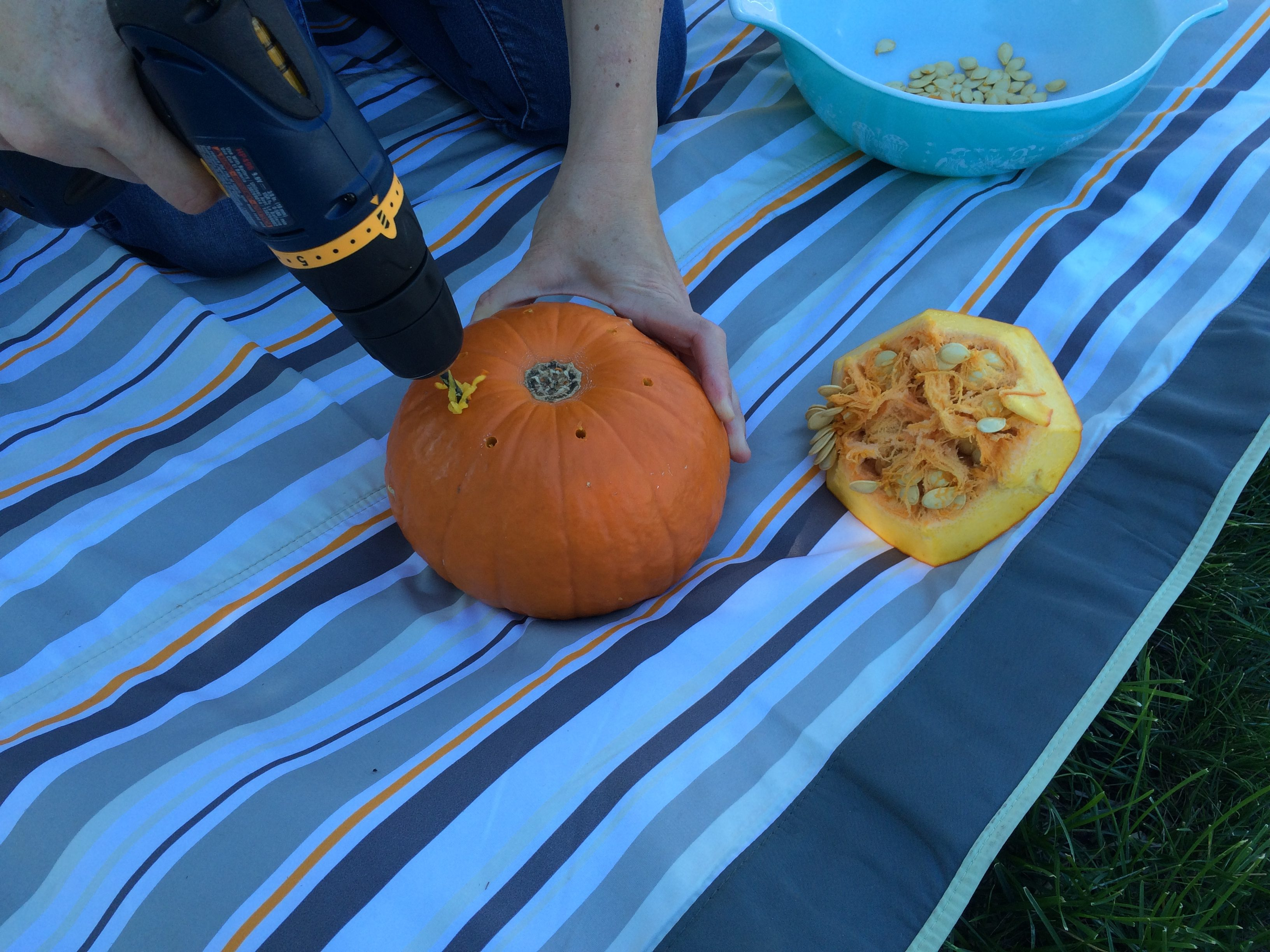 drilling holes in the bottom of the pumpkin