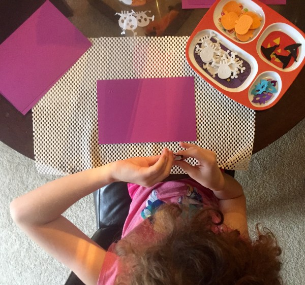 girl at table with craft activity