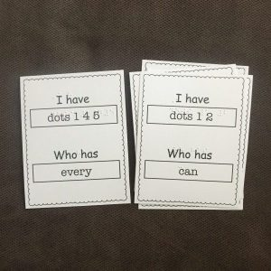 set of print and braille cards on brown background