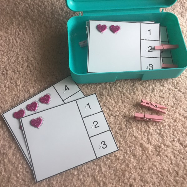 tactile heart cards with numbers 1 2 3 and pink mini clothespins near container