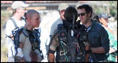 Matt Damon e il regista Neill Blomkamp sul set di Elysium