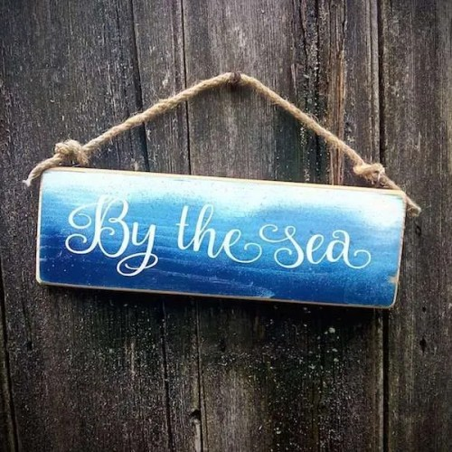 by the sea sign