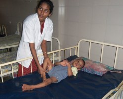 Giving Oil Massage for the Handecapped Children