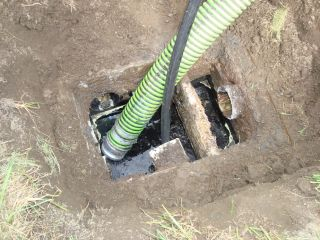 How To Repair A Septic Drain Field: Distribution Box Cleaned