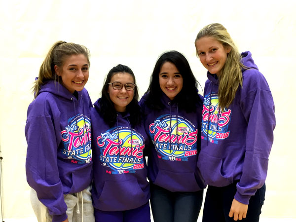 The state qualifying tennis girls pose in their  matching sweatshirt for a photo.