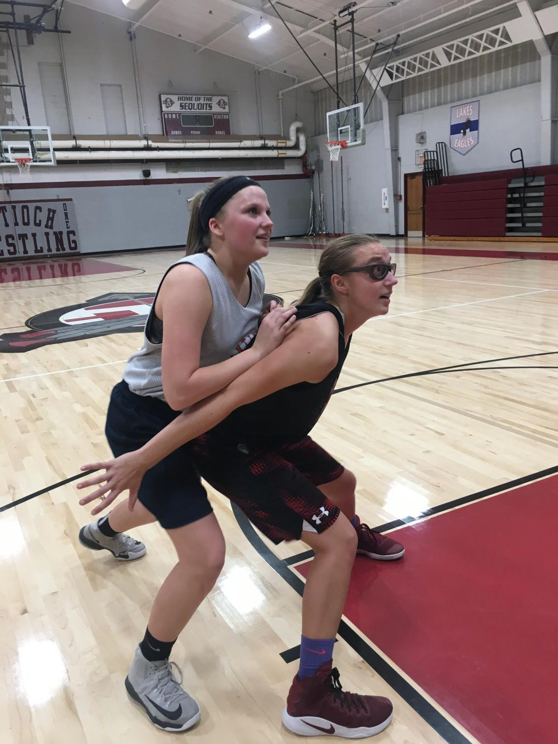 Junior Samantha Brown (right) boxes junior Kaitlynn Stay (left) to keep her from getting the rebound.