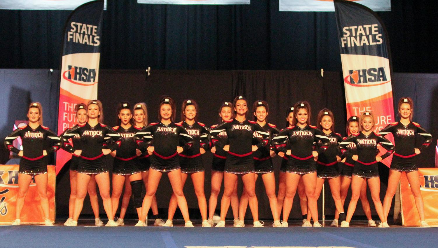 The varsity cheerleading squad stands tall, prepared for their upcoming performance on the first day of the state finals. The team advanced to day two.