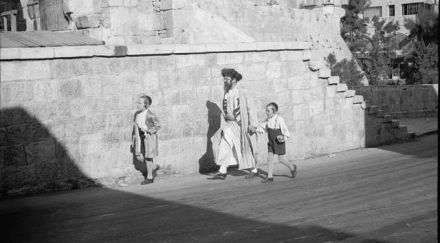 A father and his sons take a walk together in Jerusalem, 1934.