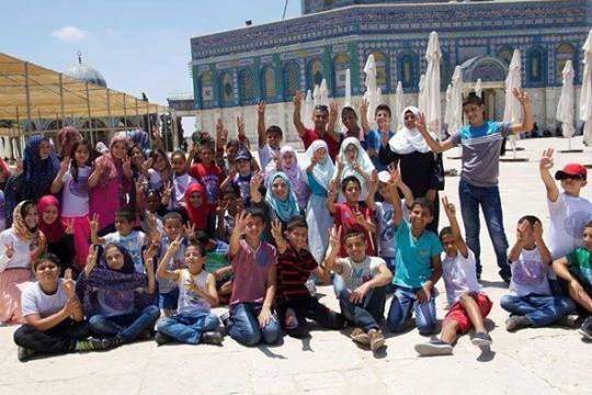 Look at this cute picture, This was photographed on the Temple Mount. These 'Palestinian' children and their teachers are celebrating the abduction of three Jewish teenagers by holding up their three fingers in what has become the viral sign of joy among the IslamoNazis at the kidnapping.
