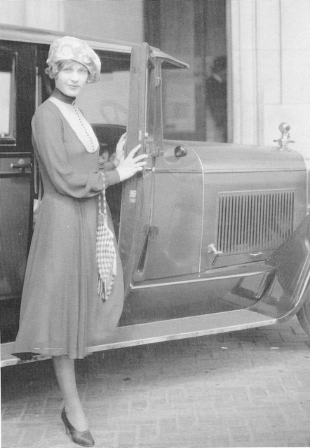 By 1927, Esther was enjoying a high standard of living. Here, she's posing with her limited edition Lincoln Town Car. Esther did not know how to drive.