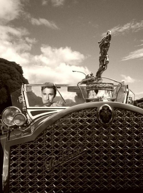 Hood ornaments were something of an art form until theft made them impractical. Here's Errol Flynn driving his Packard, 1930s.