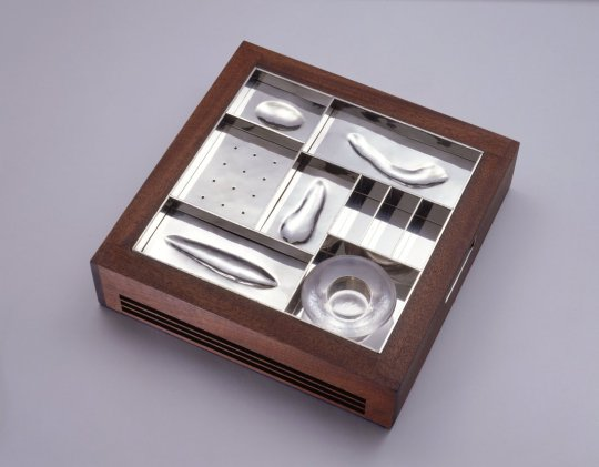 Seder Plate Amy Klein Reichert, American, b. 1959 Manufacturer: Stephen Smithers, American, b. 1951 Williamstown, Massachusetts, United States, 1997 Mahogany; silver: repoussé and pierced; glass 12 3/8 × 12 3/8 × 3 in. (31.4 × 31.4 × 7.6 cm)