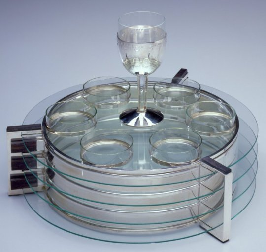 Passover Set Ludwig Yehuda Wolpert, American, b. Germany, 1900-1981 New York, United States, 1930 Frankfurt, produced 1978 Silver, ebony, and glass Seder Plate: 4 1/16 × 13 5/16 × 11 7/16 in. (10.3 × 33.8 × 29.1 cm) Cup: 6 3/16 × 2 7/8 in. (15.7 × 7.3 cm)