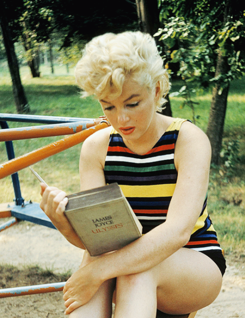 """Marilyn Monroe reading Ulysses by James Joyce. Photographed in 1955 by Eve Arnold. """"She kept 'Ulysses' in her car and had been reading it for a long time. She said she loved the sound of it and would read it aloud to herself to try to make sense of it–but she found it hard going. She couldn't read it consecutively. When we stopped at a local playground to photograph she got out the book and started to read while I loaded the film. So, of course, I photographed her."""" —Eve Arnold."""