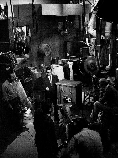 """The Twilight Zone's crew looks on as Rod Serling performs his on-camera narration for the episode Static, 1961. """"As I grow older, the urge to write gets less and less. I've pretty much spewed out everything I have to say, none of which has been particularly monumental. I've written articulate stuff, reasonably bright stuff over the years, but nothing that will stand the test of time. The good writing, like wine, has to age well with the years, and my stuff is momentarily adequate."""" -Rod Serling, 1972"""