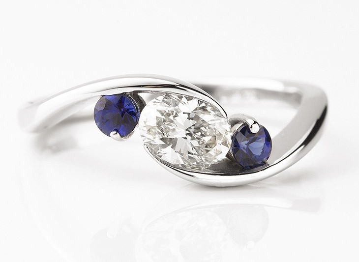 Bespoke Oval Diamond And Blue Sapphire Engagement Ring
