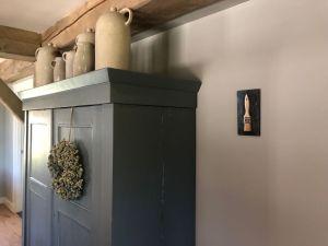 Schilderij Spalter aan de muur