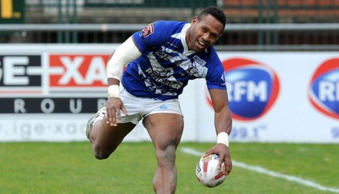 Toulouse Olympique winger Kuni Minga touches the ball down for a try.