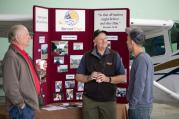 Greg Hawes (left) visits with attendee about Servant Wings
