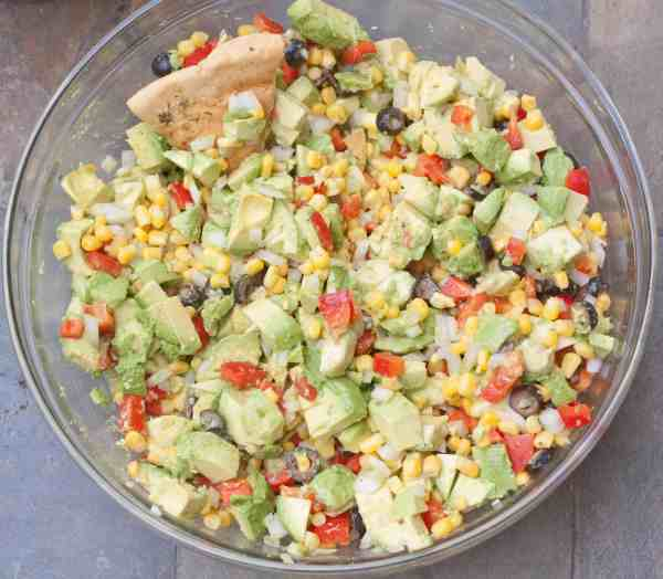 Avocado Corn Salsa: Healthy, flavorful, fresh, bright, vegan, gluten free, paleo, and nut free. The perfect crowd pleasing party snack!