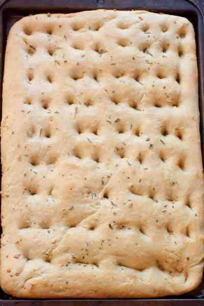 Make your own soft, salty Easy Garlic Rosemary Focaccia bread at home with just a couple of ingredients and minimal work!