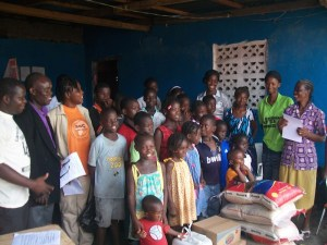 OVER 27 ORPHANS AT THE SUSIE GUENTER'S CHILDREN'S WELFARE AND REHABILITATION CENTER IN REHAB COMM.(PAYNESVILLE, LIBERIA) RECEIVING DONATIONS FROM AGC