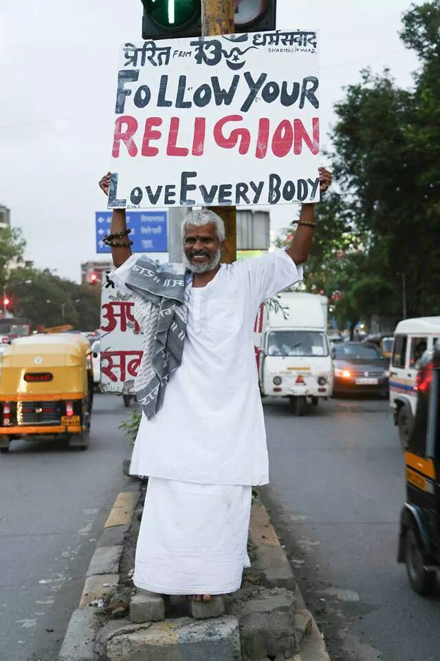 This is Krishnadas, a man who stands everyday for hours on end at Juhu Circle in Mumbai with a sign that says;'Apne dharm par chalo, sabse prem karo(Follow your religion, love everybody)'.